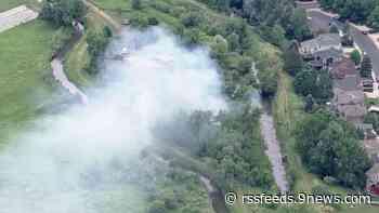 Vegetation fire burns near Arvada homes