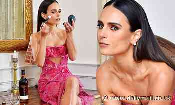 Jordana Brewster shows off her legs in a Versace dress as she has a drink before the F9 premiere