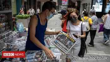Apple Daily: Hong Kong police raid sparks rush on newspapers