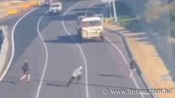 Teens narrowly avoid death running across busy Perth freeway - 9News
