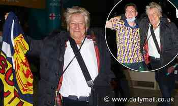 Scotland supporter Rod Stewart puts on an animated display as he leaves Wembley