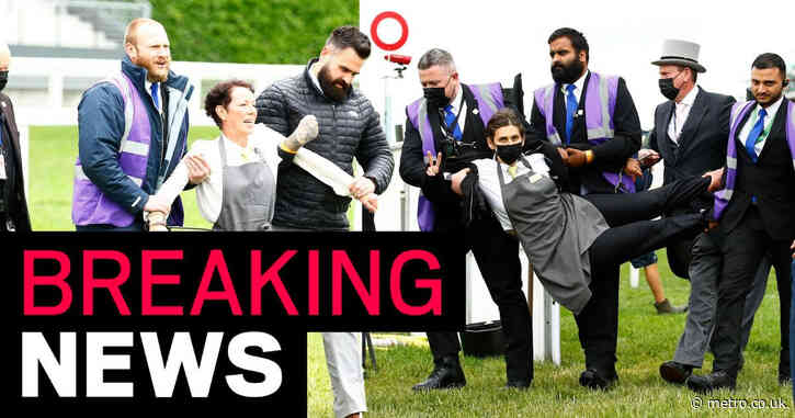 XR activists chain themselves to fence in front of Queen at Royal Ascot
