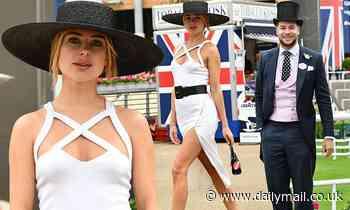 Kimberley Garner puts on a leggy display in daring white thigh-split dress