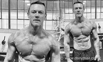 Luke Evans shows off his VERY ripped physique
