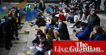 Coronavirus live news: queues for jabs at English football grounds; Brazil expected to pass 500,000 deaths - The Guardian