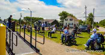 VIDEO/PHOTOS: Port Morien Wildlife Association hosts grand opening of Glace Bay accessible fishing site   Saltwire - SaltWire Network
