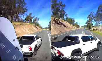 Dashcam captures nerve-wracking moment a ute towing a caravan crashes in front of a truck