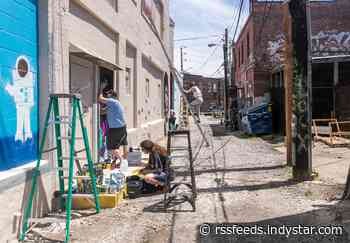 Local Indianapolis artists repaint Graffiti Alley in Fountain Square