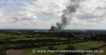 Plumes of smoke seen for miles as fire burns in Wigan - latest updates - Manchester Evening News
