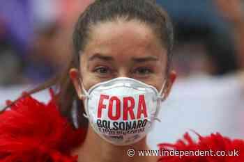 Brazil passes grim milestone of 500,000 Covid deaths amid protests over Bolsonaro response