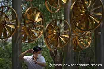 The Latest: China says 1 billion vaccine doses administered - Dawson Creek Mirror