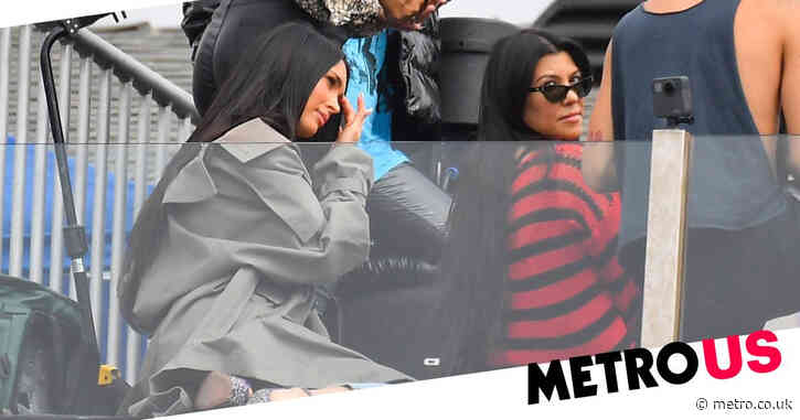 Kourtney Kardashian and Megan Fox cheerlead for rocker boyfriends as Travis Barker and Machine Gun Kelly perform