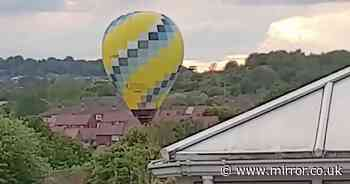 Incredible moment hot air balloon accidentally lands in a housing estate