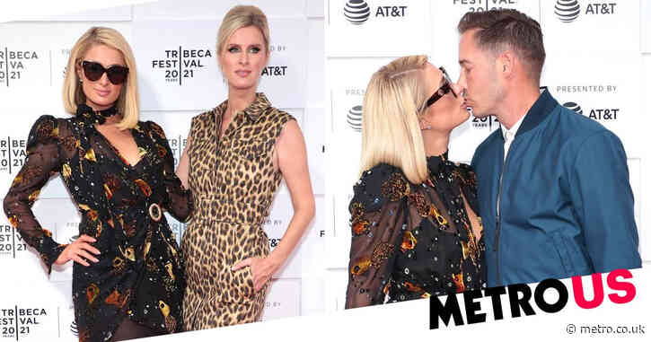 Paris Hilton all loved-up with fiancé Carter Reum on red carpet for This is Paris premiere