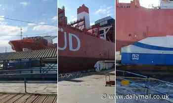 Cargo ship smashes into a ferry dock as it leaves port in Brazil