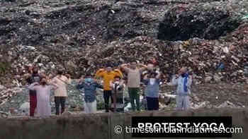 Haldwani: These people performed yoga on garbage heaps to register protest