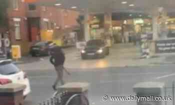 Moment two thugs armed with giant MACHETES fight each other outside petrol station