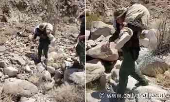 U.S. Border Patrol agent carries sickened migrant on his shoulders [VIDEO]