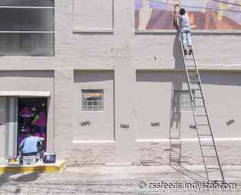 Indianapolis artists repaint murals in Fountain Square alleyway