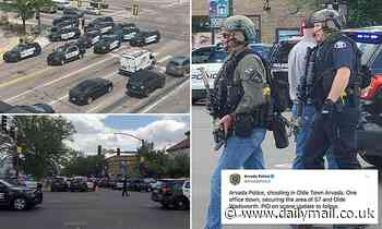 Officer 'down' after shooter opens fire in Denver suburb: Injured cop is rushed to hospital