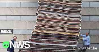 """Wereldrecord tapijten stapelen in Wevelgem: """"376 tapijten, bijna 6 meter"""" - VRT NWS"""