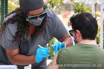US hits encouraging milestones on virus deaths and shots - Hillingdon Times