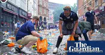 Bin there, done that: Scotland fans clean up litter in central London - The Guardian
