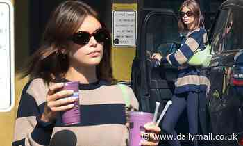 Kaia Gerber rocks a striped sweater with leggings on an afternoon smoothie run in Los Angeles