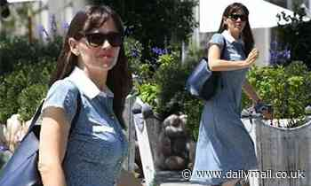 Jennifer Garner mixes function with fashion as she steps out wearing dress and trainers