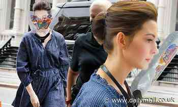 Anne Hathaway dons sticker-coated face shield and$178 Apiece Apart dress on NYC set of WeCrashed