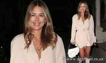 Love Island's Arabella Chi looks effortlessly chic in a cream blazer and knee-high boots
