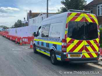 Immigration officers seen outside Portslade building site