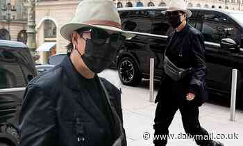 Kris Jenner keeps a low profile in a black ensemble and fedora hat at The Ritz in Paris