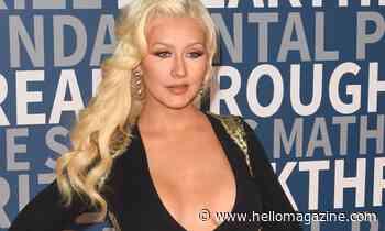 Christina Aguilera is a vision in high-cut white bodysuit