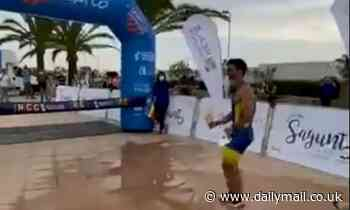 Cocky triathlete pipped to finish line after showing off with celebration as rival dashes past