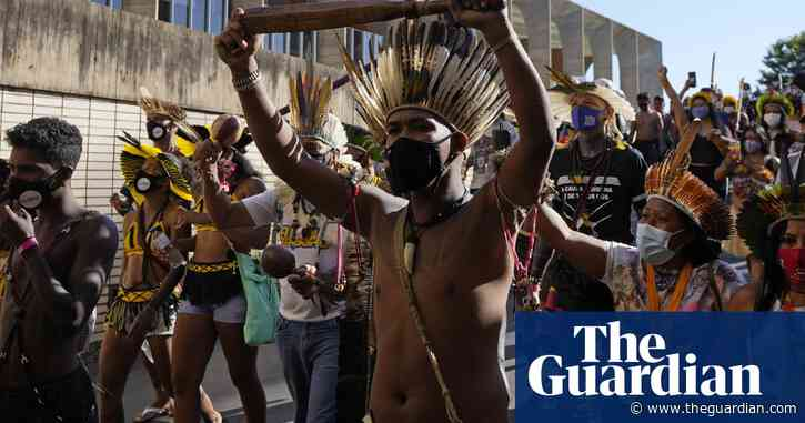 Riot police fire teargas at indigenous protest for land rights in Brazil – video
