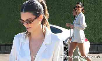 Kendall Jenner goes braless in a silky white blouse for lunch with friends at Soho House Malibu