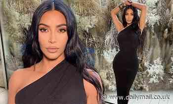 Kim Kardashian slips hourglass figure into slinky black gown