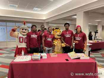 Troy football and nonprofit 'team-up' to encourage youth literacy - WSFA