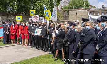 Let us fly again! Furious pilots and cabin crews march on Westminster - Daily Mail
