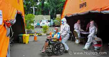 Indonesia reports record daily rise of 20574 coronavirus cases - Reuters