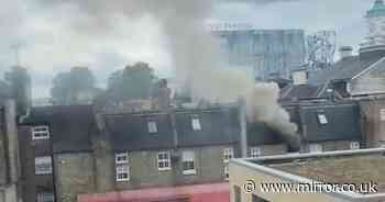 'Explosion' heard before fire and smoke pour out of building with roads closed