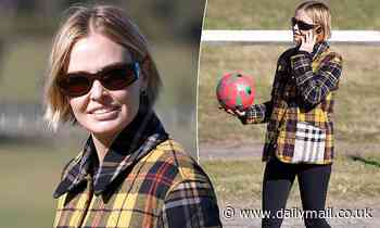 Lara Bingle plays soccer with her two young songs inCentennial Park