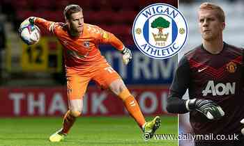Wigan beat rivals to the signing of former Manchester United goalkeeper Ben Amos