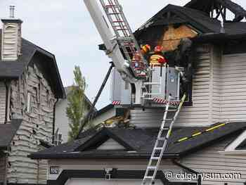 RCMP at scene of Chestermere house fire where two families were staying - Calgary Sun