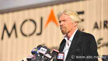 Branson plans space trip for next month, pipping Bezos by a week