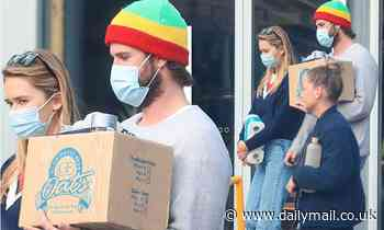 Liam Hemsworth and girlfriend Gabriella Brooks grab some essentials in Byron Bay - Daily Mail
