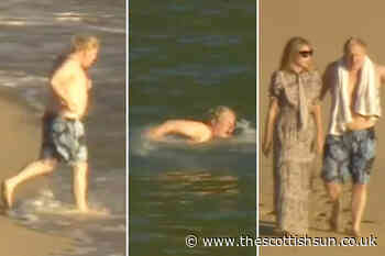 Boris Johnson channels David Hasselhoff as he runs straight into the sea for a swim before drying off with... - The Scottish Sun