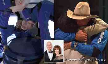 Bezos and brother greet mother from space, before hugging her and giving her a feather necklace