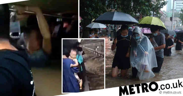 Passengers trapped in waist-high flood waters on subway in China
